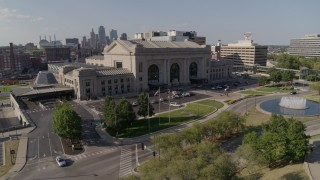 DX0001_001309 - 5.7K stock footage aerial video orbiting an historic train station and fountain in Kansas City, Missouri