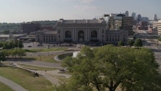 DX0001_001310 - 5.7K stock footage aerial video fly over fountain to approach historic train station in Kansas City, Missouri