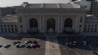 DX0001_001312 - 5.7K stock footage aerial video reverse view of historic train station, reveal fountain in Kansas City, Missouri