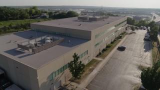 DX0001_001317 - 5.7K stock footage aerial video of circling FBI office building in Kansas City, Missouri