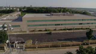 DX0001_001318 - 5.7K stock footage aerial video flyby and orbit FBI office building in Kansas City, Missouri