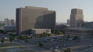 DX0001_001335 - 5.7K stock footage aerial video fly to entrance of government office building in Downtown Kansas City, Missouri