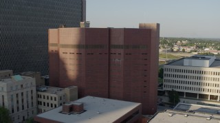 DX0001_001337 - 5.7K stock footage aerial video fly away from a city prison in Downtown Kansas City, Missouri