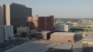 DX0001_001338 - 5.7K stock footage aerial video fly toward a city prison in Downtown Kansas City, Missouri
