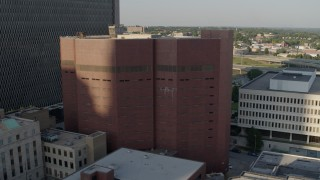 DX0001_001339 - 5.7K stock footage aerial video of a reverse view of a city prison in Downtown Kansas City, Missouri