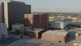 DX0001_001340 - 5.7K stock footage aerial video of a stationary view of a city prison in Downtown Kansas City, Missouri