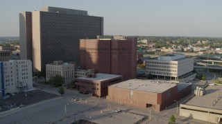 DX0001_001341 - 5.7K stock footage aerial video of orbiting a city prison in Downtown Kansas City, Missouri