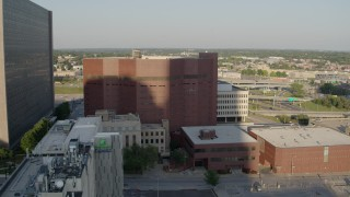 DX0001_001342 - 5.7K stock footage aerial video of orbiting around a city prison in Downtown Kansas City, Missouri
