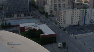 DX0001_001343 - 5.7K stock footage aerial video of three cars stopped at a light at sunset in Downtown Kansas City, Missouri