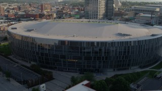 DX0001_001344 - 5.7K stock footage aerial video of a close orbit of an arena at sunset in Downtown Kansas City, Missouri