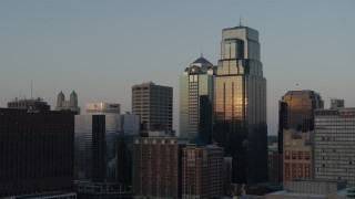 DX0001_001355 - 5.7K stock footage aerial video static view of light reflecting off of skyscrapers at sunset in Downtown Kansas City, Missouri