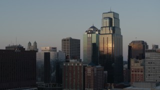 DX0001_001356 - 5.7K stock footage aerial video static view and flyby of skyscrapers at sunset in Downtown Kansas City, Missouri