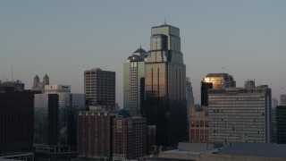 DX0001_001357 - 5.7K stock footage aerial video flyby skyscrapers reflecting the sunset in Downtown Kansas City, Missouri
