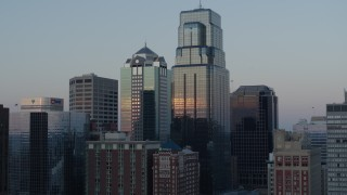 DX0001_001363 - 5.7K stock footage aerial video ascend and orbit tall city skyscrapers at sunset in Downtown Kansas City, Missouri