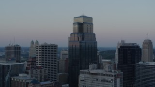 DX0001_001364 - 5.7K stock footage aerial video descend and orbit tall city skyscrapers at sunset in Downtown Kansas City, Missouri