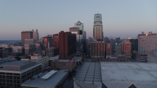 DX0001_001365 - 5.7K stock footage aerial video ascend and pass by tall city skyscrapers at sunset in Downtown Kansas City, Missouri