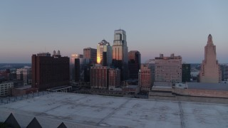 DX0001_001368 - 5.7K stock footage aerial video flyby tall downtown skyscrapers near hotel at sunset in Downtown Kansas City, Missouri
