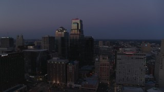 DX0001_001394 - 5.7K stock footage aerial video descend with a view of skyscrapers at twilight in Downtown Kansas City, Missouri