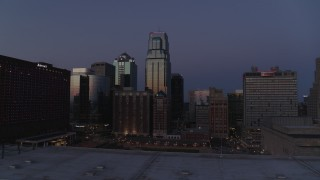 DX0001_001395 - 5.7K stock footage aerial video of skyscrapers between hotels and city buildings at twilight in Downtown Kansas City, Missouri