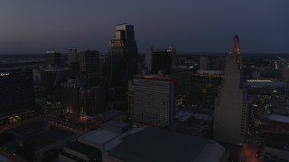 DX0001_001398 - 5.7K stock footage aerial video flyby and descend with view of hotel and skyscrapers at twilight in Downtown Kansas City, Missouri