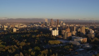 DX0001_001404 - 5.7K stock footage aerial video of skyscrapers seen from apartment complexes at sunrise, Downtown Denver, Colorado