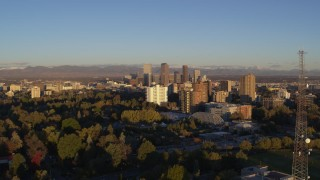 DX0001_001408 - 5.7K stock footage aerial video flyby radio tower near apartment buildings for view of skyscrapers at sunrise, Downtown Denver, Colorado