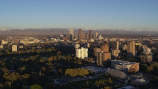 DX0001_001409 - 5.7K stock footage aerial video of skyscrapers at sunrise, seen from apartment buildings, Downtown Denver, Colorado