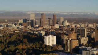 DX0001_001412 - 5.7K stock footage aerial video of a reverse view of skyscrapers in Downtown Denver, Colorado at sunrise