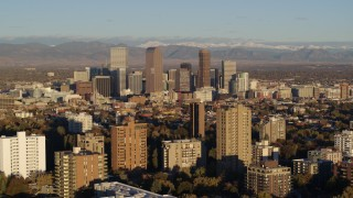 DX0001_001414 - 5.7K stock footage aerial video of skyscrapers in Downtown Denver, Colorado at sunrise, seen while flying by apartment buildings