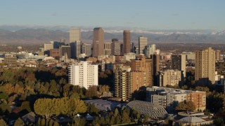 DX0001_001417 - 5.7K stock footage aerial video of tall skyscrapers in Downtown Denver, Colorado at sunrise, seen while descending near apartment buildings