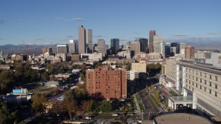 DX0001_001422 - 5.7K stock footage aerial video ascend from apartment building to reveal skyscrapers in Downtown Denver, Colorado