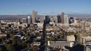 DX0001_001424 - 5.7K stock footage aerial video of a reverse view of skyscrapers in Downtown Denver, Colorado