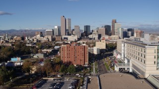 DX0001_001432 - 5.7K stock footage aerial video of the city's skyscrapers, descend near apartment building in Downtown Denver, Colorado