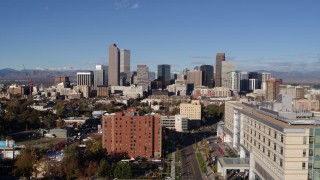 DX0001_001436 - 5.7K stock footage aerial video of slowly flying away from skyscrapers in Downtown Denver, Colorado