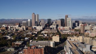DX0001_001438 - 5.7K stock footage aerial video a reverse view of skyscrapers in Downtown Denver, Colorado, seen while descending