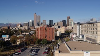 DX0001_001439 - 5.7K stock footage aerial video of skyscrapers in Downtown Denver, Colorado, seen while descending near apartment building