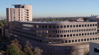 DX0001_001444 - 5.7K stock footage aerial video of orbiting a hospital in Denver, Colorado