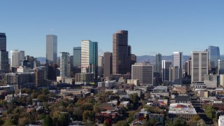 DX0001_001450 - 5.7K stock footage aerial video stationary and reverse view of the city's skyscrapers in Downtown Denver, Colorado