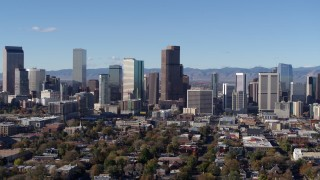 DX0001_001456 - 5.7K stock footage aerial video flying by skyscrapers in Downtown Denver, Colorado skyline