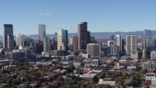 DX0001_001458 - 5.7K stock footage aerial video ascend and flyby skyscrapers in Downtown Denver, Colorado skyline