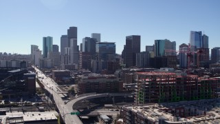 DX0001_001472 - 5.7K stock footage aerial video ascend near construction site for view of skyline in Downtown Denver, Colorado