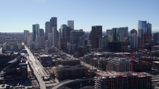 DX0001_001475 - 5.7K stock footage aerial video of a reverse view of skyline in Downtown Denver, Colorado
