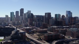 DX0001_001478 - 5.7K stock footage aerial video of a stationary view and flyby of skyline in Downtown Denver, Colorado