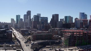 DX0001_001482 - 5.7K stock footage aerial video of skyline seen while descending in Downtown Denver, Colorado