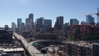 DX0001_001483 - 5.7K stock footage aerial video reveal the city skyline while ascending in Downtown Denver, Colorado