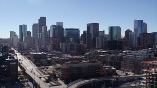 DX0001_001485 - 5.7K stock footage aerial video of the city skyline seen while descending near offramp in Downtown Denver, Colorado