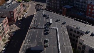 DX0001_001489 - 5.7K stock footage aerial video of flying over apartment building rooftop in Downtown Denver, Colorado