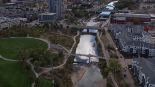 DX0001_001499 - 5.7K stock footage aerial video of the South Platte River and bridges in Downtown Denver, Colorado