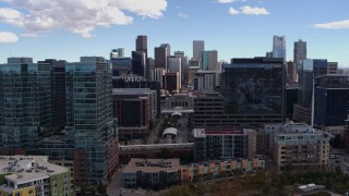 DX0001_001503 - 5.7K stock footage aerial video descend near office buildings with view of skyline in Downtown Denver, Colorado