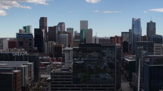 DX0001_001506 - 5.7K stock footage aerial video of the city's skyline seen while descending near office buildings in Downtown Denver, Colorado